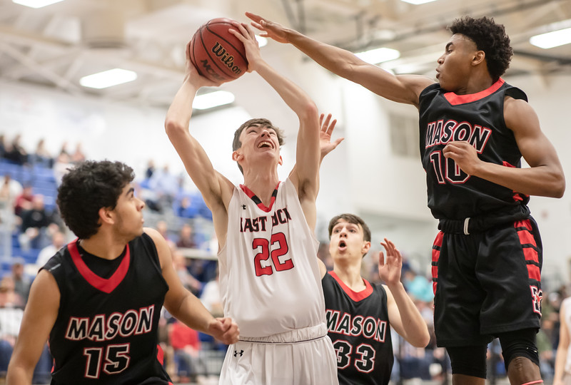 Dalton Jefferson finds himself surrounded by the Mason defence