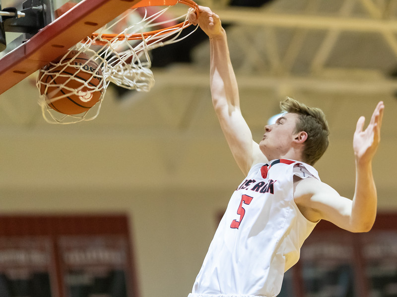 Tyler Nickel goes up for an easy dunk