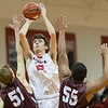 Dalton Jefferson takes a jumpshot over Luray's Cordell Judy and Patrick Porter