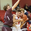 Isaac Kisling tries to squeeze between two Luray defenders