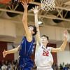 Kaleb Strawderman gets past Dalton Jefferson for a shot under the basket