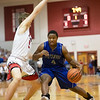 Elijah Mushagasha drives in. towards the basket