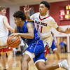 Michael Hunter drives by Tyce McNair