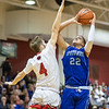 Collin Wigley attempts to block a shot from Angel Pacheco-Ortiz