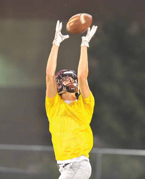 Bud Denega | The Sheridan Press<br /> Kade VanDyken catches a ball during the Rams' Midnight Madness, which kicked off the fall practice season, at Big Horn High School Monday, August 13, 2018.