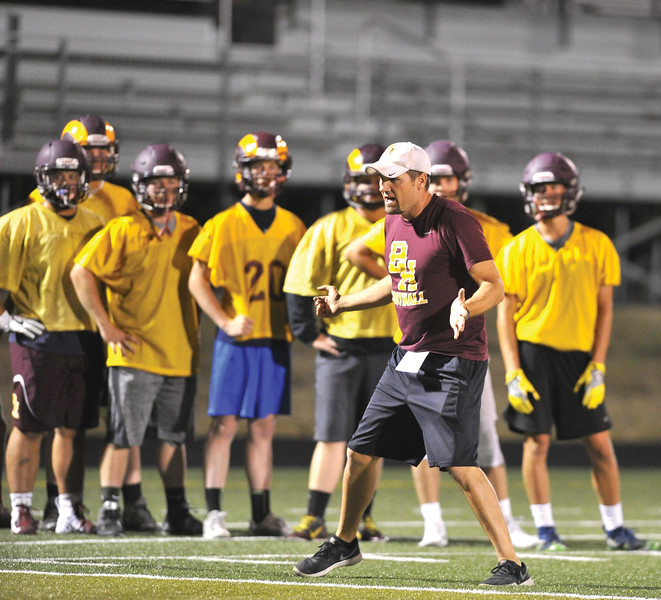 Bud Denega | The Sheridan Press<br /> Big Horn football head coach Kirk McLaughlin goes over a drill during the Rams' Midnight Madness, which kicked off the fall practice season.