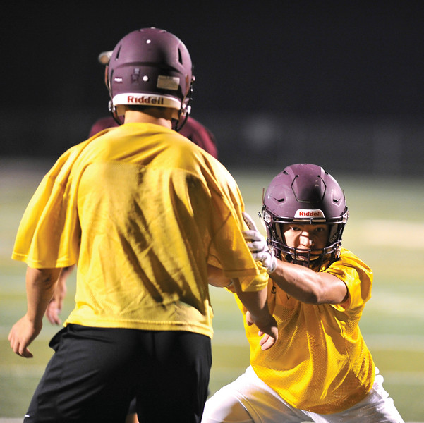Bud Denega | The Sheridan Press<br /> Kade Eisele goes through a drill during the Rams' Midnight Madness, which kicked off the fall practice season, at Big Horn High School Monday, August 13, 2018.