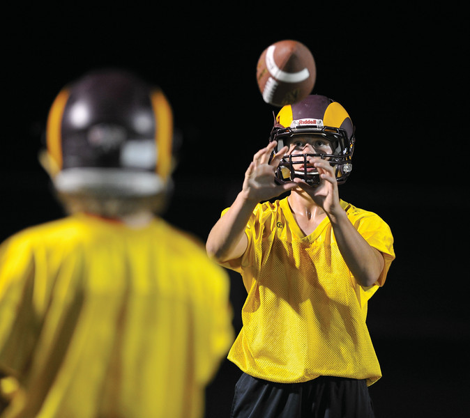 Bud Denega | The Sheridan Press<br /> Quinn McCafferty eyes a ball during the Rams' Midnight Madness, which kicked off the fall practice season, at Big Horn High School Monday, August 13, 2018.