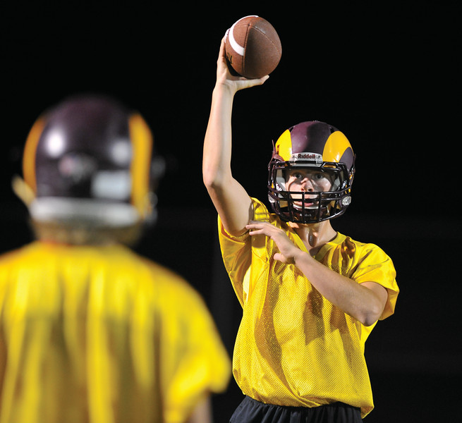 Bud Denega | The Sheridan Press<br /> Quinn McCafferty tosses a ball during the Rams' Midnight Madness, which kicked off the fall practice season, at Big Horn High School Monday, August 13, 2018.
