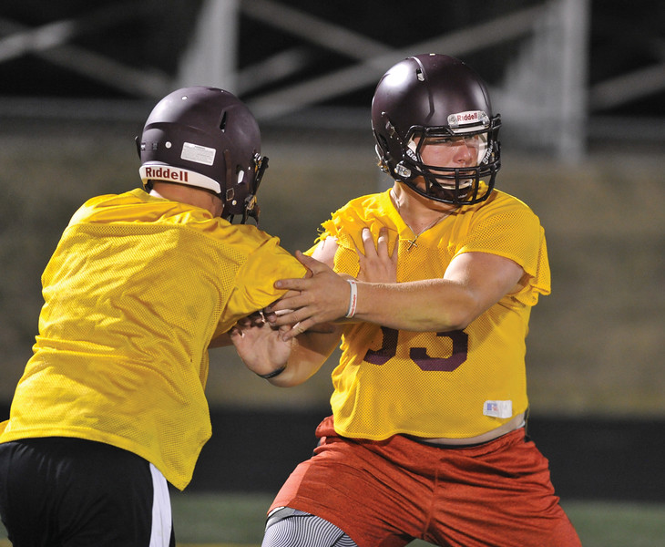 Bud Denega | The Sheridan Press<br /> Seth Mullinax goes through a drill during the Rams' Midnight Madness, which kicked off the fall practice season, at Big Horn High School Monday, August 13, 2018.