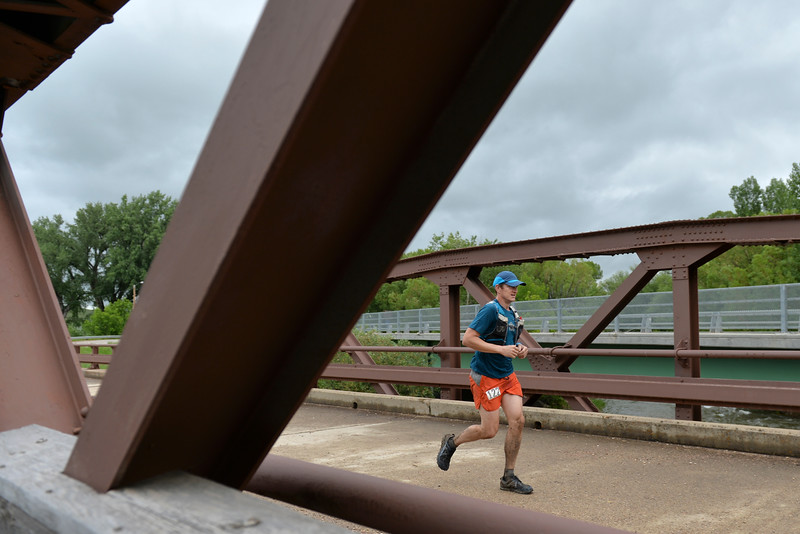 Justin Sheely | The Sheridan Press<br /> 100-miler Matt Hall of Squamish, British Columbia, crosses the bridge into Dayton during the Bighorn Mountain Wild and Scenic Trail Run at Scott Park in Dayton Saturday, June 16, 2018.