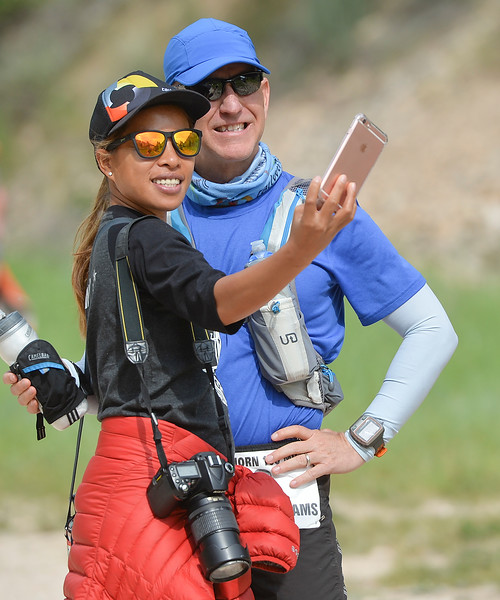 Justin Sheely | The Sheridan Press<br /> Colorado couple Rose Adams snaps a selfie with Michael Adams before 100-mile race during the Bighorn Mountain Wild and Scenic Trail Run at the Amsden Creek fishing area near Dayton Friday, June 15, 2018.