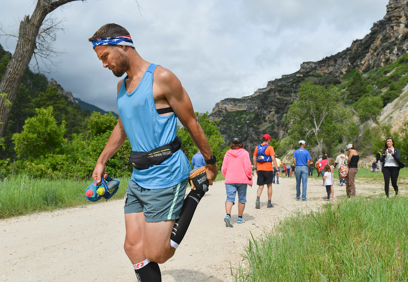 Justin Sheely | The Sheridan Press<br /> Rory Morgan of Ft. Collins, Colorado, stretches before 100-mile race during the Bighorn Mountain Wild and Scenic Trail Run at the Amsden Creek fishing area near Dayton Friday, June 15, 2018.