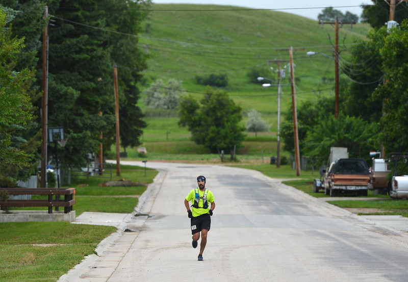 Justin Sheely | The Sheridan Press<br /> Josh Fuller of Jackson, Wyoming, makes the final stretch of the 100-mile race during the Bighorn Mountain Wild and Scenic Trail Run in Dayton Saturday, June 16, 2018.