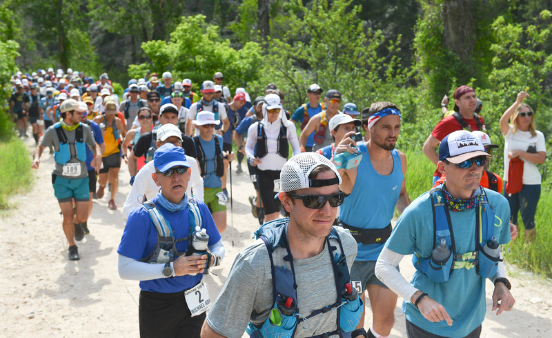 Justin Sheely | The Sheridan Press<br /> Competitors start the 100-mile race during the Bighorn Mountain Wild and Scenic Trail Run at the Amsden Creek fishing area near Dayton Friday, June 15, 2018.