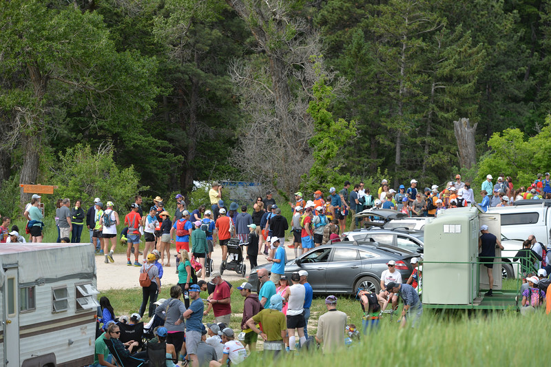 Justin Sheely | The Sheridan Press<br /> Runners and their friends and families prepare for the start of the 100-mile race during the Bighorn Mountain Wild and Scenic Trail Run at the Amsden Creek fishing area near Dayton Friday, June 15, 2018.