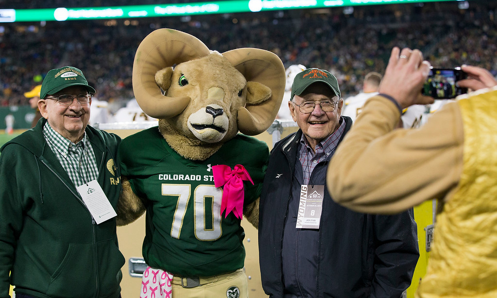 . Colorado State fans get their picture taken with CAM the RAM on the sideline Friday evening Oct., 26 2018 at Canvas Stadium in Fort Collins. (Michael Brian/For the Reporter-Herald)