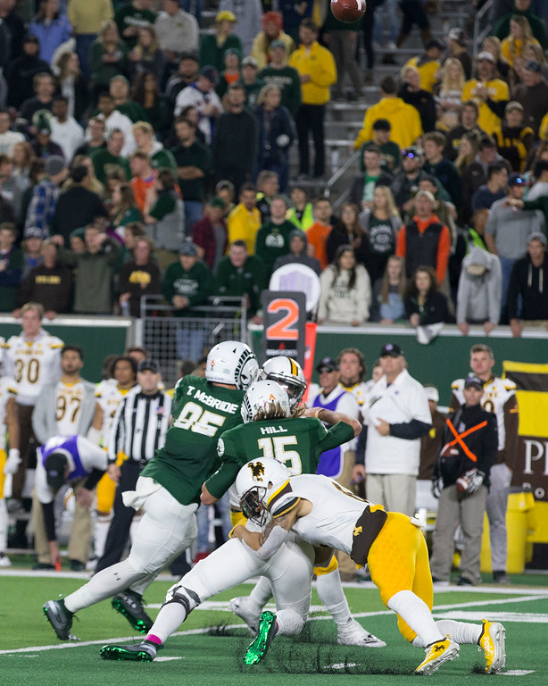 . A Wyoming sack of Colorado State quarterback Collin Hill (15) sends the ball sailing skyward Friday evening Oct., 26 2018 at Canvas Stadium in Fort Collins. (Michael Brian/For the Reporter-Herald)