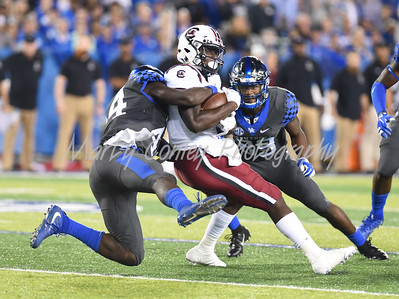 Kentucky's Jamin Davis tackles Deebo Samuel of South Carolina on Saturday evening.  MARTY CONLEY/ FOR THE DAILY INDEPENDENT