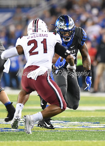 Benny Snell Jr. of Kentucky heads upfield on Saturday against South Carolina.  MARTY CONLEY/ FOR THE DAILY INDEPENDENT