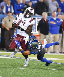 Kentucky's Zach Johnson wraps up South Carolina's Bryan Edwards on Saturday evening.  MARTY CONLEY/ FOR THE DAILY INDEPENDENT