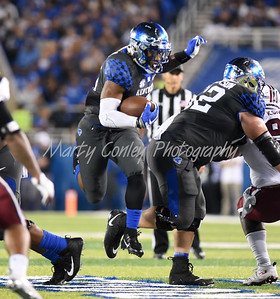 Benny Snell Jr. of Kentucky leaps through an opening on Saturday evening against South Carolina.  MARTY CONLEY/ FOR THE DAILY INDEPENDENT