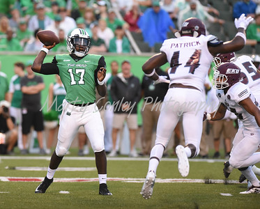 Marshall quarterback, Isaiah Green throws a pass under pressure against EKU on Saturday evening.  MARTY CONLEY/ FOR THE DAILY INDEPENDENT
