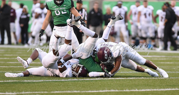 Marshall's Tyler King gets tackled by the Eastern Kentucky defense on Saturday evening.  MARTY CONLEY/ FOR THE DAILY INDEPENDENT