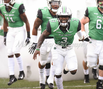 The Marshall Thundering Herd take the field on Saturday evening against Eastern Kentucky.  MARTY CONLEY/ FOR THE DAILY INDEPENDENT