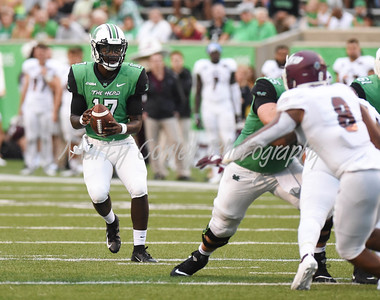Marshall quarterback, Isaiah Green drops back to pass on Saturday evening against EKU.  MARTY CONLEY/ FOR THE DAILY INDEPENDENT