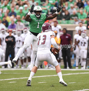 Marshall's Ty Tyler pressures EKU quarterback, Dakota Allen on Saturday.  MARTY CONLEY/ FOR THE DAILY INDEPENDENT