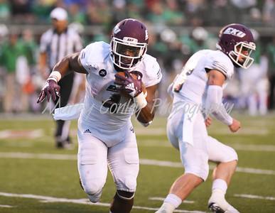 LJ Scott of Eastern Kentucky takes the handoff on Saturday evening against Marshall.  MARTY CONLEY/ FOR THE DAILY INDEPENDENT