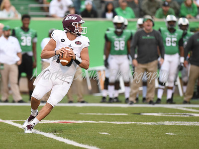 Eastern Kentucky quarterback, Dakota Allen drops back to pass against Marshall on Saturday evening.  MARTY CONLEY/ FOR THE DAILY INDEPENDENT