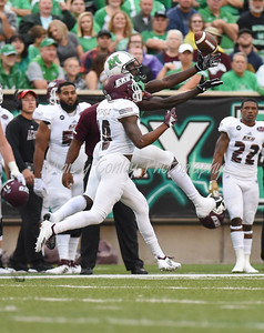 Marshall's Tyre Brady stretches to make the catch on Saturday against EKU.  MARTY CONLEY/ FOR THE DAILY INDEPENDENT