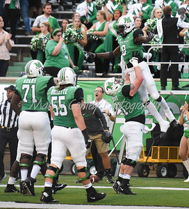 Marshall's Levi Brown picks up Tyre Brady after a score on Saturday against EKU. MARTY CONLEY/ FOR THE DAILY INDEPENDENT
