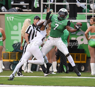 Obi Obialo of Marshall attempts to pull in a pass on Saturday against EKU.  MARTY CONLEY/ FOR THE DAILY INDEPENDENT