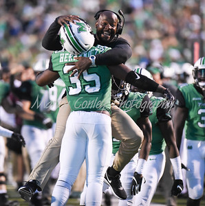 Marshall assistant coach, Cornell Brown hugs Frankie Hernandez after an interception on Saturday against EKU.  MARTY CONLEY/ FOR THE DAILY INDEPENDENT