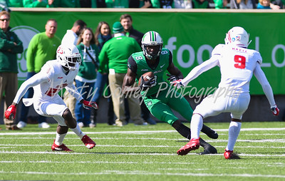 Marshall's Tyre Brady looks for an opening after a reception on Saturday against Florida Atlantic.  MARTY CONLEY/ FOR THE DAILY INDEPENDENT