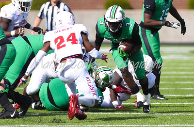 Tyler King of Marshall rushes with the football on Saturday against Florida Atlantic.  MARTY CONLEY/ FOR THE DAILY INDEPENDENT