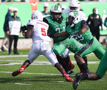 Marshall's Malik Gant and Channing Hames cut off FAU's Devin Singletary on Saturday.  MARTY CONLEY/ FOR THE DAILY INDEPENDENT