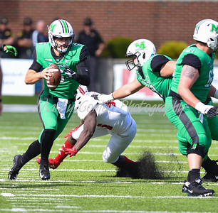 Marshall quarterback, Alex Thomson looks for a running lane on Saturday against Florida Atlantic.  MARTY CONLEY/ FOR THE DAILY INDEPENDENT