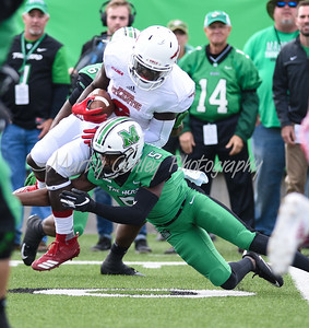 Marshall's Kereon Merrell tackles FAU's Kerrith Whyte Jr. on Saturday.  MARTY CONLEY/ FOR THE DAILY INDEPENDENT