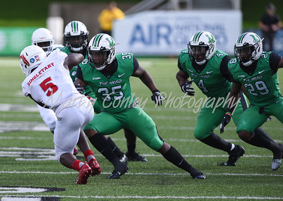 The Marshall defense swarm Florida Atlantic's Devin Singletary on Saturday.  MARTY CONLEY/ FOR THE DAILY INDEPENDENT