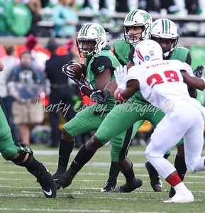 Keion Davis of Marshall looks for an opening on Saturday against FAU.  MARTY CONLEY/ FOR THE DAILY INDEPENDENT