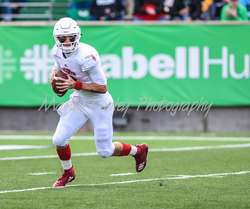 FAU quarterback, Chris Robinson rolls out to pass on Saturday against Marshall.  MARTY CONLEY/ FOR THE DAILY INDEPENDENT