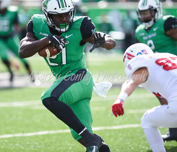 Marshall's Artis Johnson runs with ball after making the interception against FAU on Saturday.  MARTY CONLEY/ FOR THE DAILY INDEPENDENT