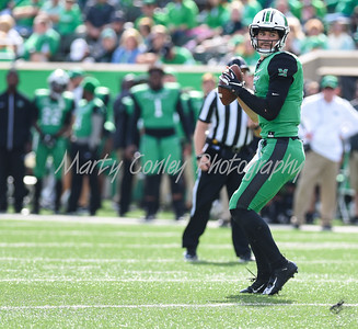 Marshall quarterback, Alex Thomson looks for an open receiver on Saturday against FAU.  MARTY CONLEY/ FOR THE DAILY INDEPENDENT