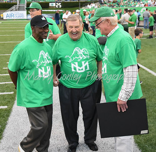 Former Marshall head coach, Jack Lengyel shares a laugh with former assistant coaches, Mickey Jackson and Red Dawson on Saturday evening.  MARTY CONLEY/ FOR THE DAILY INDEPENDENT