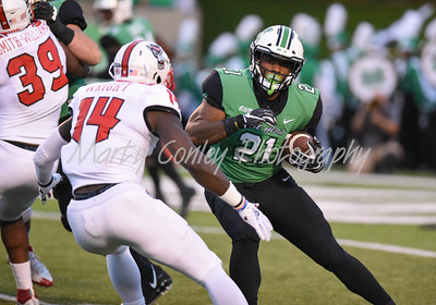 Marshall running back, Anthony Anderson looks for running room as North Carolina State's Dexter Wright applies pressure on Saturday evening.  MARTY CONLEY/ FOR THE DAILY INDEPENDENT