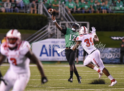 Marshall quarterback, Isaiah Green releases a pass as North Carolina State's James Smith-Williams applies pressure on Saturday.  MARTY CONLEY/ FOR THE DAILY INDEPENDENT